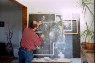Artist Doug Czor working in his studio