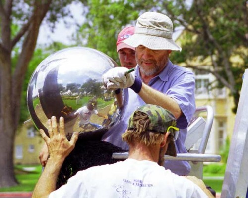 """""""Reaching For The Stars,"""" Artist installing the Stainless Steel Sphere"""